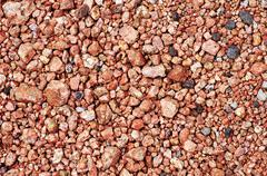 small rocks background. red rocky background - stock photo
