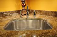 Stock Photo of silver sink and granite countertop. kitchen interiors