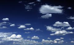 dark blue sky with few clouds - summer sky - stock photo