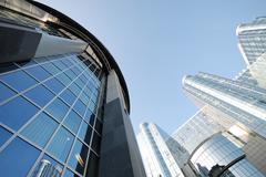 european architecture - glass and metal buildings - stock photo