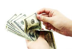dollars counting. female hands counting usd american dollars. - stock photo