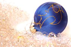 Christmas ball and a tinsel Stock Photos