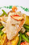Roasted Dorade with seafood and French beans - stock photo