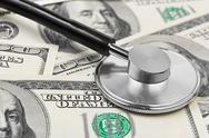 Stock Photo of Stethoscope on money background