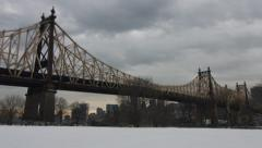 4K NYC Queensboro bridge cloudy snow covered day - stock footage