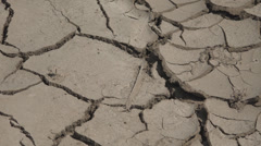 Closeup detail dry ground mud barren terrain concept pattern desert texture soil Stock Footage