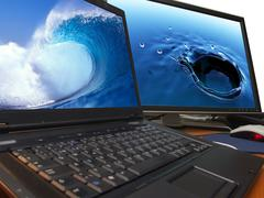water concept on laptop and big widescreen tft display - stock photo