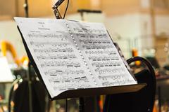 Musical instruments and sheet music - stock photo