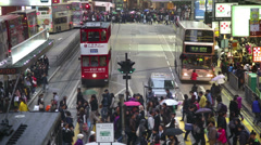Shoppers crossing street with tram / Street car Stock Footage