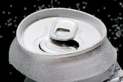 Crumpled beverage can with bubbles macro - stock photo
