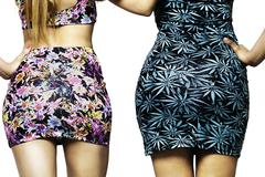 women wearing floreal dresses backside - stock photo
