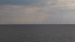 Farm of wind turbines in the sea Stock Footage