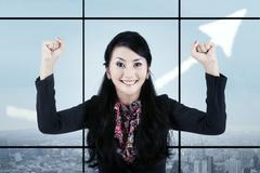 Businesswoman celebrating her accomplishment Stock Illustration