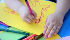 Child drawing closeup on color paper, childhood diversity. Stock Footage