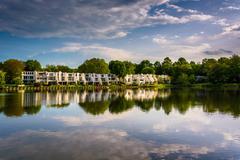 beautiful sky reflecting in wilde lake, in columbia, maryland. - stock photo