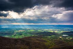 crepuscular rays over the shenandoah valley, seen from little stony man mount - stock photo