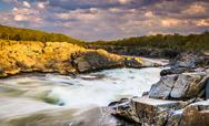 Stock Photo of evening light on rocks and rapids in the potomac river, at great falls park,