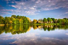 evening reflections at wilde lake in columbia, maryland. - stock photo