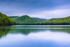 Long exposure of clouds moving over mountains and long pine run reservoir in  Stock Photos
