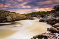 Stock Photo of long exposure of rapids at sunset on the potomac river at great falls park, v