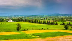 storm clouds over fields and distant mountains seen from longstreet observati - stock photo