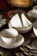 18th century cups and saucers crockery on inlaid wooden serving tray Stock Photos