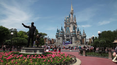 Cinderella's Castle and Mickey and Walt Disney statue 1 Stock Footage