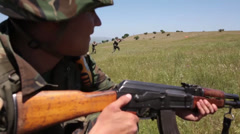Soldiers attack with AK47 - stock footage