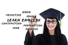 Stock Illustration of female bachelor writes english materials