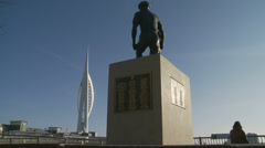 Mudlark statue facing Spinnaker tower, Portsmouth Stock Footage
