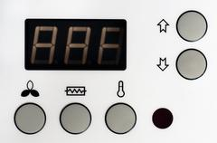Closeup of a thermostat with big buttons and display Stock Photos
