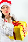 Girl giving a big kiss and a present Stock Photos
