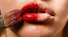 Conceptual photo of a makeup and the lips of a girl Stock Photos