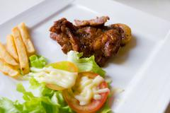 pork steak with french fries - stock photo