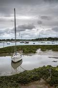 Landscape of moody evening sky over low tide marine Stock Photos