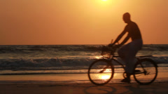 man ride bicycles outdoors - stock footage