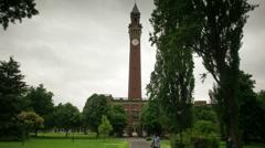 Birmingham University Clock Tower moving time lapse. Stock Footage