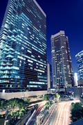 Tall office buildings by night Stock Photos