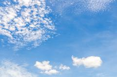 puffy clouds and blue sky in sunny day - stock photo