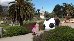 Children playing with a huge inflatable ball in the Golden Gate Park. Stock Footage