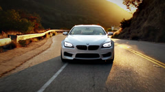 BMW Driving through Los Angeles the hills at Sunset Stock Footage