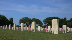 Rows of military gravestones decorated with flags. 4K Stock Footage