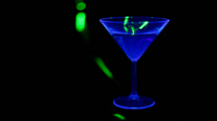 Cocktail under UV light Stock Footage