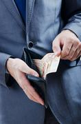 Stock Photo of Man with euro banknotes
