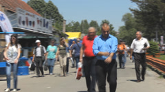 Walking in the city,steady cam the shadows of people on the road City Life Stock Footage