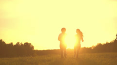 $Romantic young couple silhouette, holding hands and running forward  Stock Footage
