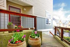 entrance porch with flower pots - stock photo
