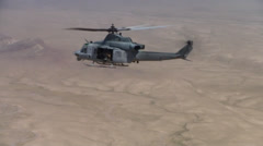 Stock Video Footage of isolation view of huey helicopter over the desert of afghanistan  (HD)