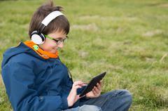 Boy with a laptop Stock Photos