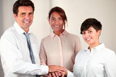 Attractive business people with unity symbol Stock Photos